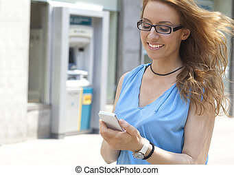 Woman on street with smartphone