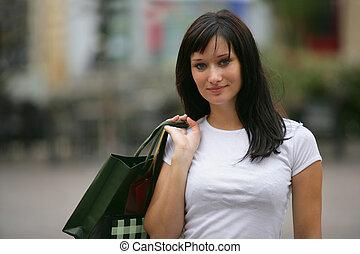 Woman on successful shopping trip