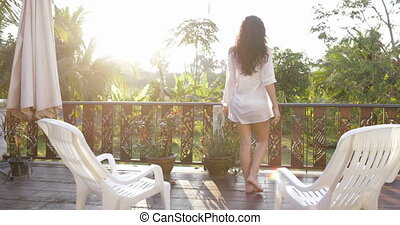 Woman On Summer Terrace Enjoy View Of Tropical Forest At Sunset Back Rear Of Attractive Brunette Girl Outdoors