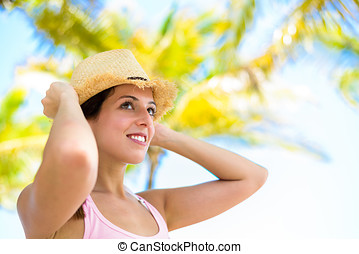 Woman on summer tropical vacation