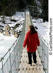 Woman on suspension bridge