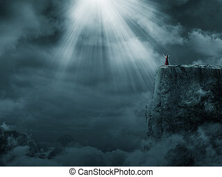A woman standing on a tall mountain under the bright light