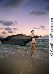 woman on the beach at sunrise
