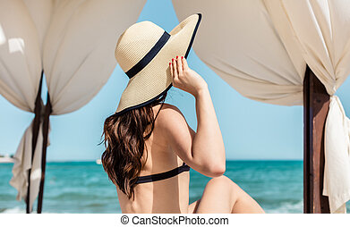 Woman on the beach in sun tent