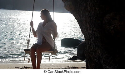 woman on the beach near the sea meditating