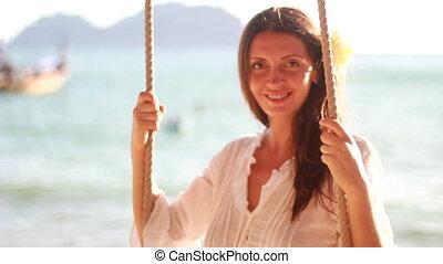 woman on the beach near the sea meditating