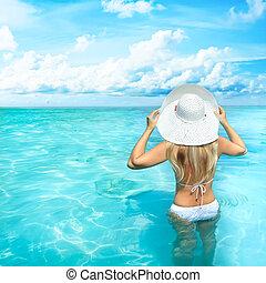 Woman on the beach - Rear view of woman at Maya bay....