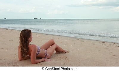Woman on the beach relaxing near sea