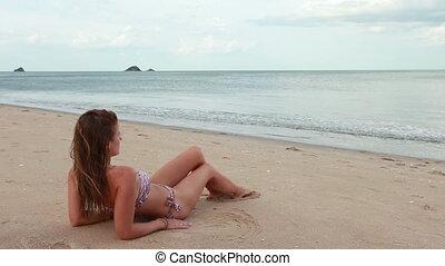 Woman on the beach relaxing near sea
