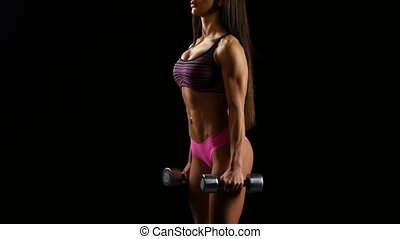 Woman on the bench pulling dumbbell