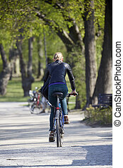 Woman on the bicycle in park