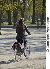 Woman on the bicycle in the park