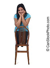 woman on the chair on with background