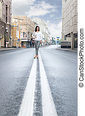 Woman on the dividing strip