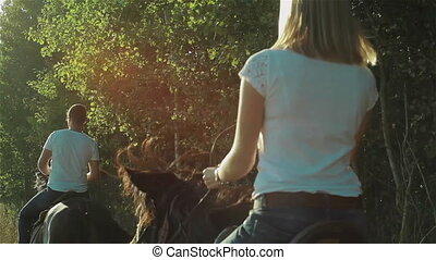 Woman on the horse in sunset light