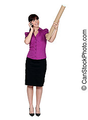 Woman on the phone and holding a cardboard mailing tube