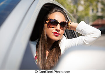 woman on the phone in her car