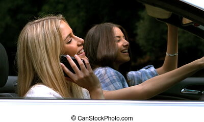 Woman on the phone while driving - Happy woman on the phone...