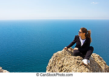 woman on the rock and sea