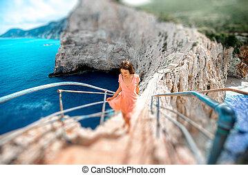 Woman on the rocky island beach