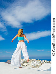 WOman on the rooftop in Santorini Greece