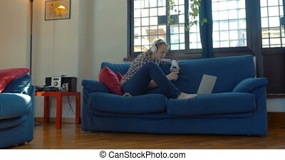 Woman on the sofa at home having video chat