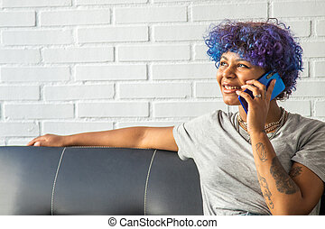 woman on the sofa at home with mobile phone