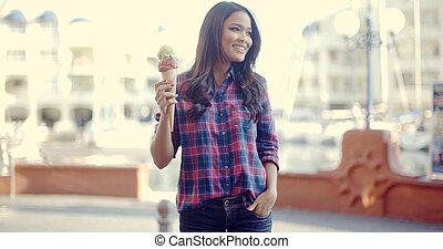 Woman On The Street Eating Ice Cream