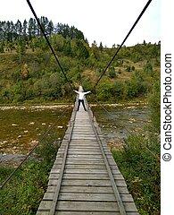woman on the suspension bridge