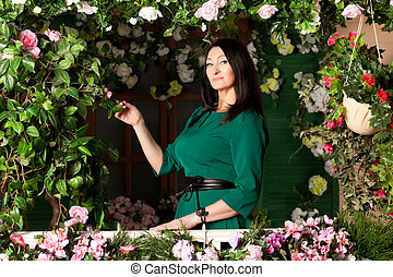 Woman on the veranda with flowers