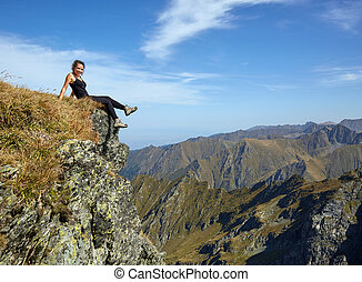Woman on top of the mountain