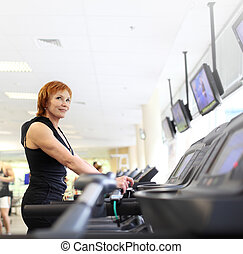 Woman on trademill in gym