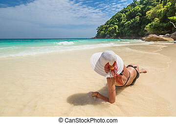 Woman on tropical white beach