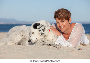 woman on vacation with pet dog
