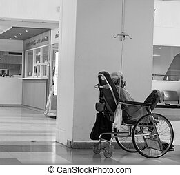 woman on wheelchair waiting for medicine