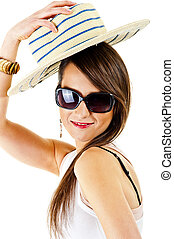 Woman on white background with sunglasses adn hat
