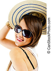 Woman on white background with sunglasses and hat