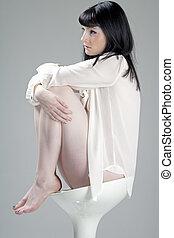 Woman on white stool