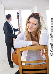 Woman on wooden chair smile on camera