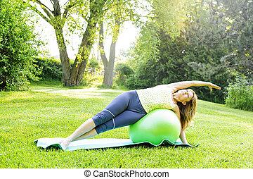Woman on yoga balance ball