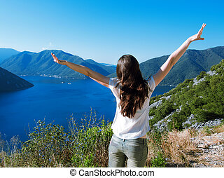 woman open arms to the sunrise stand top of mountain - woman...