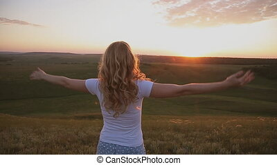 woman open arms under the sunrise at field - woman open arms...