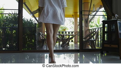 Woman Open Door And Walking Out On Terrace Looking At Tropical Forest Landscape Back Rear View, Attractive Brunette Girl In Man Shirt