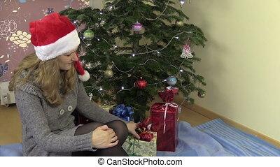 woman open gift box