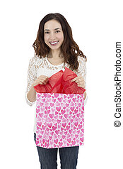 Woman opening a paper gift bag