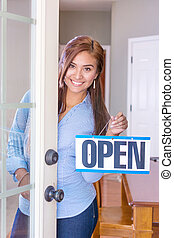 Woman Opening A Store - Woman opening her store with an open...
