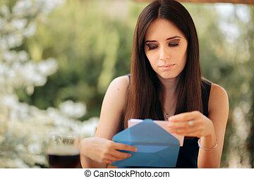 Woman Opening an Envelope Receiving Serious News