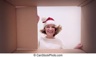 Woman opening cardboard box - Young happy woman with...