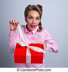 Woman opening christmas box