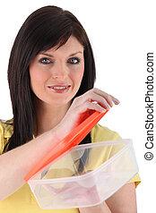 Woman opening food storage box